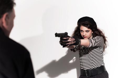 trespasser: Bold eighties fashion girl in black and white. Shooting on man. Studio shot against white wall.