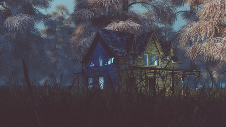 misty forest: Abandoned house with lights on field in misty autumn forest at night. Stock Photo