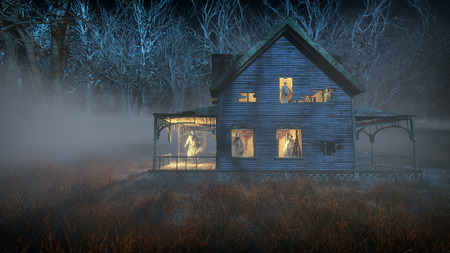 Spooky halloween house with ghosts standing in the windows.