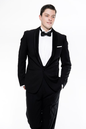 dinner jacket: New years eve fashion man wearing black dinner jacket. Isolated against white.