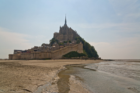 st michel: The tidal causeway leading to Mont St Michel with its fortified abbey and monastery off the coast of Normandy, France, an important tourist and pilgrimage site