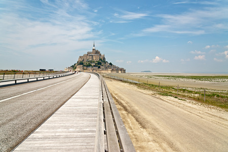 st michel: Highway leading to Mont St Michel, Normandy, France with its monastery and abbey enclosed in fortified walls on a tidal island off the coast, a popular tourist and pilgrimage destination