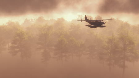 flying float: Float plane or seaplane flying in fog or mist above an evergreen coniferous forest in an atmospheric ethereal landscape depicting wilderness transportation and sightseeing Stock Photo