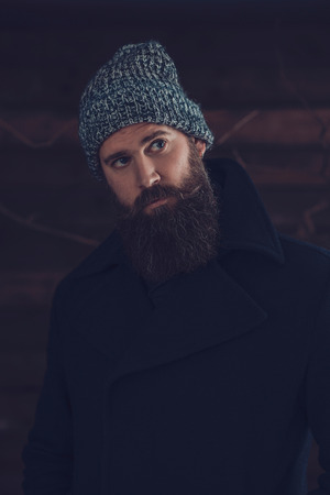 observant: Close up Gorgeous Young Man with Long Beard, Wearing Winter Fashion Outfit, Looking Afar.