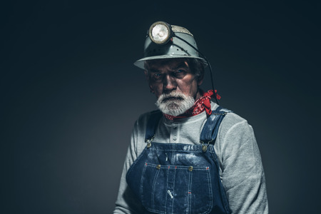 Close up Pensive Bearded Old Gold Miner, Looking Into Distance Seriously Against Gray Gradient Background