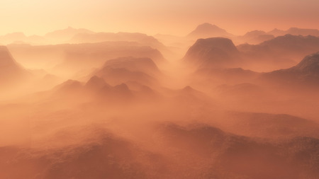 mist: Mountain range glowing in the mist at sunrise. Aerial view.