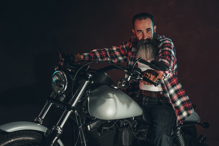 long beard: Casual cool long beard man on motorcycle.