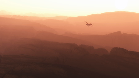 private airplane: Private airplane flying over mountains in morning mist. Stock Photo