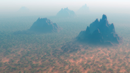 mist: Aerial of dense forest with mountain peaks in the mist.