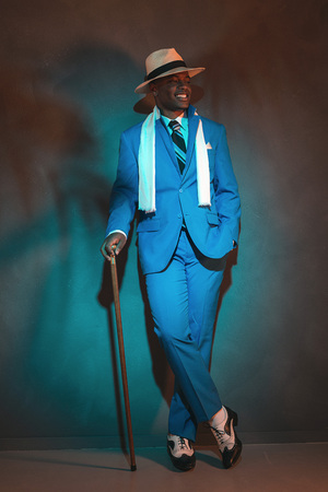 dandy: African american dandy man in blue suit and straw hat. Holding cane. Stock Photo