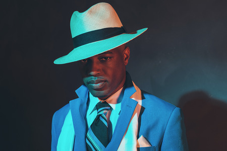 dandy: African american dandy man in blue suit and straw hat.