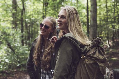 twin sister: Twin sister having fun in forest.