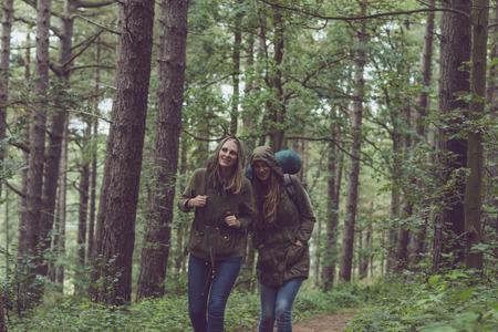 twin sister: Hiking twin sister having fun in forest.