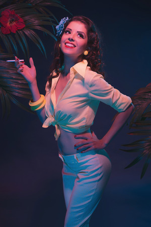 sexual girl: Cigarette Smoking Tropical Fashion Pin-up in Evening Light with Palm Leaves.
