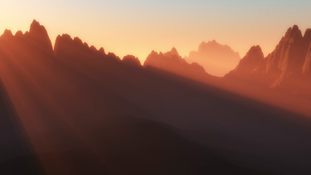 terraced: Silhouettes of mountain peaks with sun beams at sunset. Stock Photo