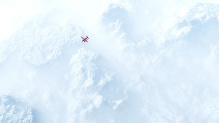 fog: Small red airplane flying over snow mountains in the mist. High angle view.