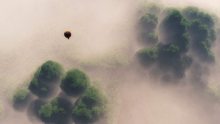 misty forest: Aerial of hot air balloon floating above misty forest.