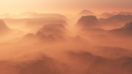 mountain view: Mountain range glowing in the mist at sunrise. Aerial view.