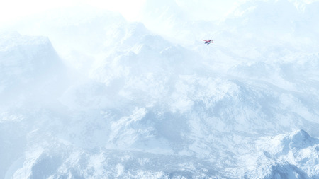 high angle view: Small red airplane flying over snow mountains in the mist. High angle view.