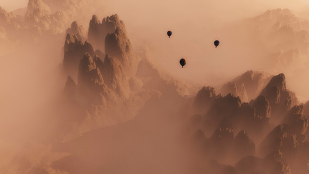 sunrise mountain: High angle view of rocky mountain landscape with hot air balloons in the mist at sunrise.