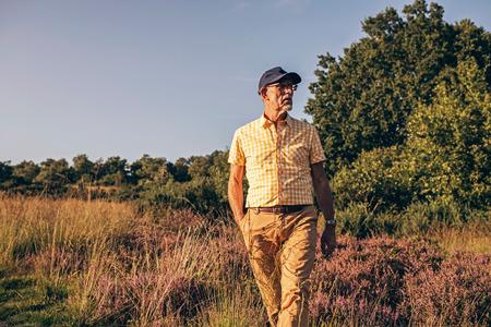 heathland: Active retired man walking in heathland.