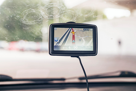 car navigation: Car navigation system on window.