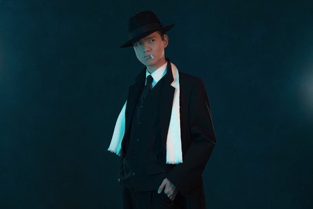 asian man face: Retro 1940 asian gangster fashion man. Smoking cigarette.