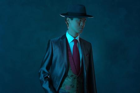 hitman: Vintage 1940 asian gangster fashion man. Stock Photo