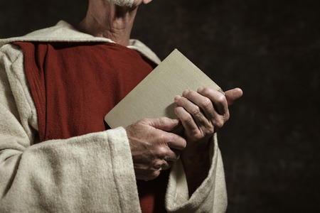 monastic: Close-up of monastic hands holding book.