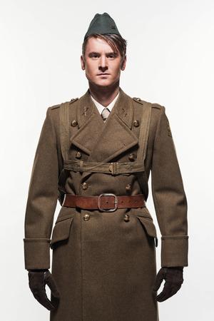 double breasted: Paratrooper military uniform fashion man against white background. Foto de archivo