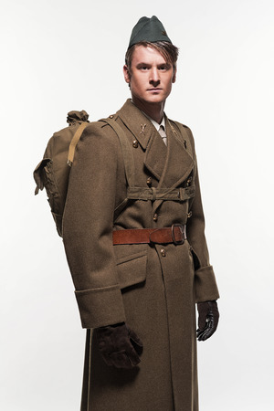 double breasted: Paratrooper military uniform fashion man against white background. Stock Photo