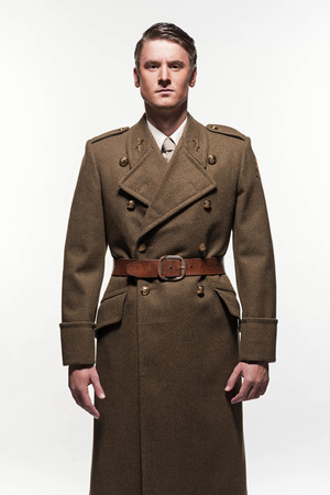 double breasted: Military uniform fashion man against white background.