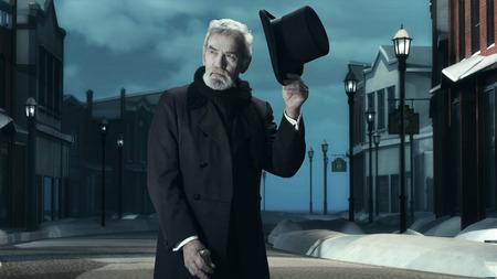 Dickens Scrooge Man in Old Winter Street. Taking Hat Off.