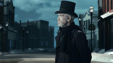 dickens: Dickens Scrooge Man in Old Winter Street. Side View.