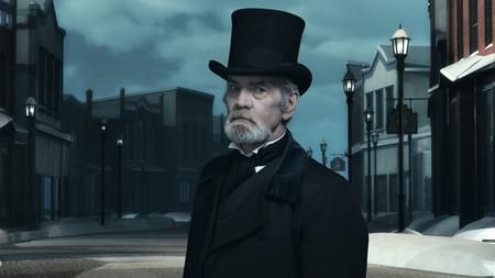 dickens: Dickens Scrooge Man in Old Winter Street. Stock Photo