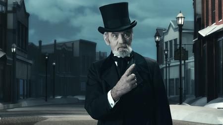 dickens: Dickens Scrooge Man in Old Winter Street. Pointing FInger.