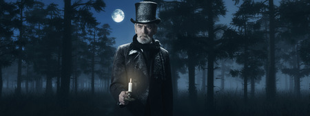 dickens: Dickens Scrooge Man with Candlestick in Foggy Winter Forest at Moonlight.