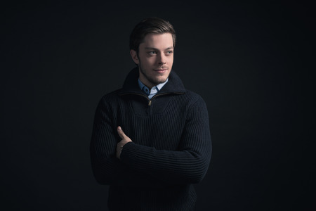 stubbly: Man wearing dark blue winter sweater and blue shirt.