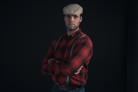 stubbly: Hipster lumberjack fashion man wearing red checkered shirt and cap.