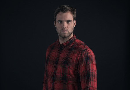 stubbly: Hipster lumberjack fashion man in red checkered shirt.