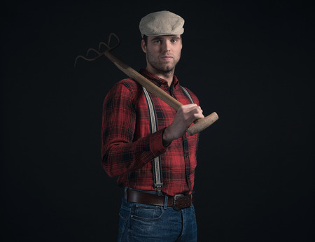 stubbly: Cool fashionable farmer wearing red checkered shirt and cap. Stock Photo