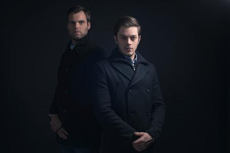 stubbly: Two men in dark blue winter coat.