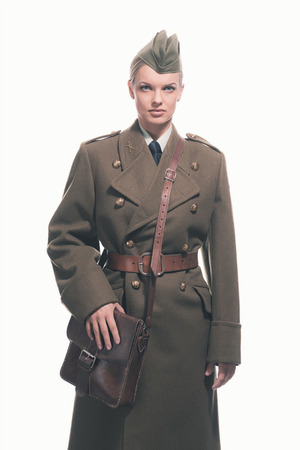 one girl: Retro army uniform fashion woman isolated against white.