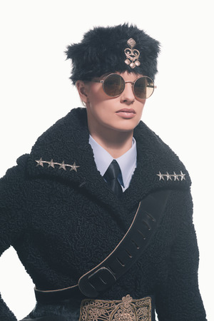 russian hat: Female guard wearing vintage russian winter costume with hat isolated against white.