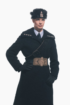 female police: Female guard wearing retro russian winter costume with hat isolated against white. Stock Photo