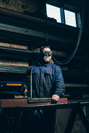 rugged man: Welder with goggles
