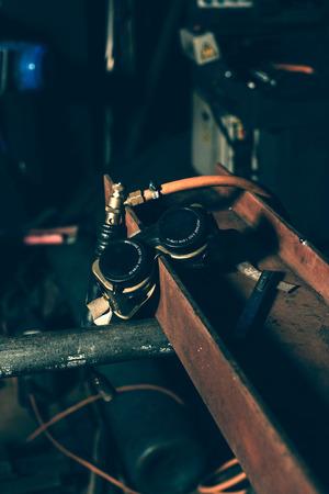 blowtorch: Welding goggles on iron beam Stock Photo