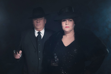 dangerous love: Retro 1940s gangster couple. Classic portrait.