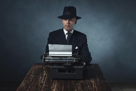 late 40s: Vintage 1940 office worker behind desk with typewriter.