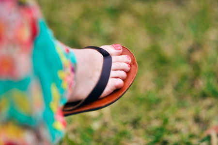 bodypart: Woman foot with nail polish wearing flip-flop Stock Photo